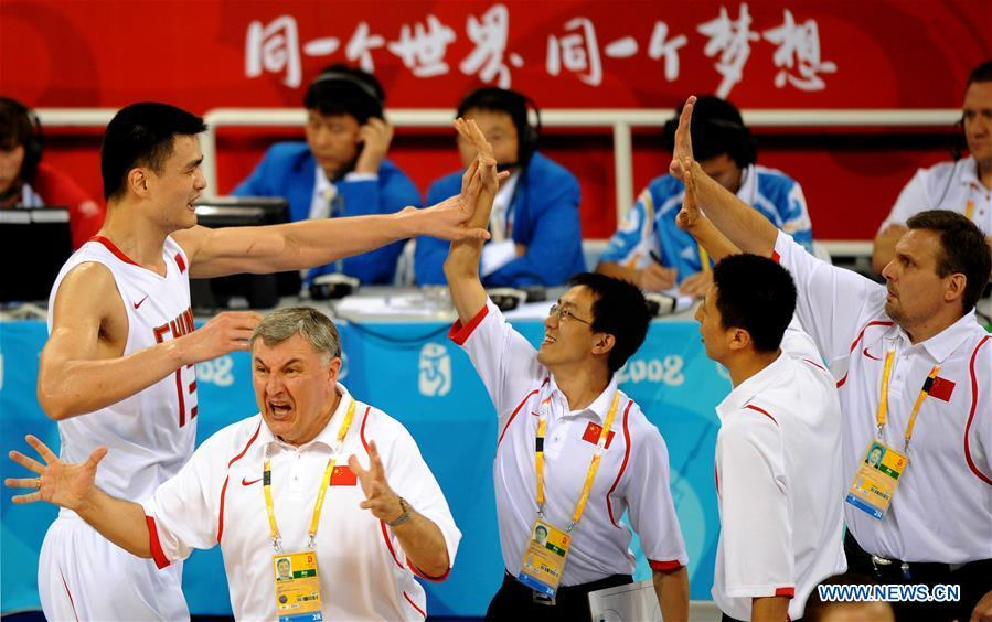 Yao Ming (L) of China celebrates with teammates after defeating Germany in a group match to be qualified for the quarterfinals at the Olympic Games in Beijing, capital of China, Aug. 16, 2008. This year marks the 70th anniversary of the founding of the People\'s Republic of China (PRC). On April 5, 1959, Rong Guotuan won the champion of the men\'s singles event at the 25th ITTF World Table Tennis Championships in Dortmund, Germany, becoming China\'s first ever world champion. Chinese players have made more achievements during the 60 years since then. (Xinhua/Li Gang)