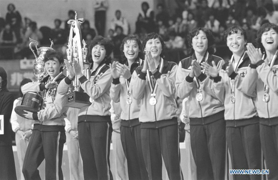 Members of the women\'s volleyball team of China attend the awarding ceremony after winning the gold medal with seven straight victories at the FIVB Women\'s Volleyball World Cup in Osaka, Japan, Nov. 16, 1981. This year marks the 70th anniversary of the founding of the People\'s Republic of China (PRC). On April 5, 1959, Rong Guotuan won the champion of the men\'s singles event at the 25th ITTF World Table Tennis Championships in Dortmund, Germany, becoming China\'s first ever world champion. Chinese players have made more achievements during the 60 years since then. (Xinhua/Li Qirong)
