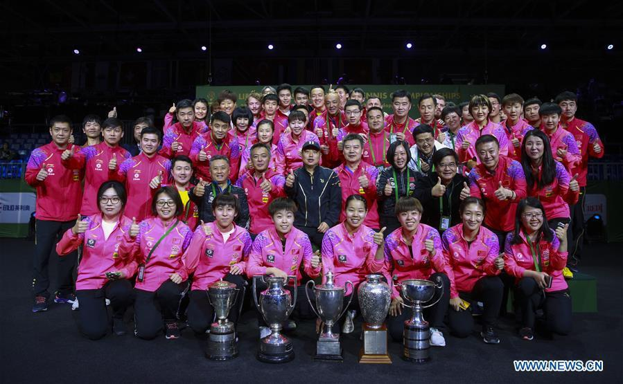 The Chinese table tennis team poses for a group photo after the 2019 ITTF World Table Tennis Championships in Budapest, Hungary, April 28, 2019. This year marks the 70th anniversary of the founding of the People\'s Republic of China (PRC). On April 5, 1959, Rong Guotuan won the champion of the men\'s singles event at the 25th ITTF World Table Tennis Championships in Dortmund, Germany, becoming China\'s first ever world champion. Chinese players have made more achievements during the 60 years since then. (Xinhua/Han Yan)