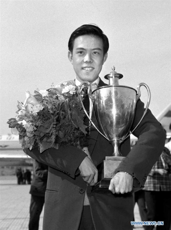Rong Guotuan holds the trophy upon returning to China April 22, 1959 from the 25th ITTF World Championships held in Dortmund of Germany. This year marks the 70th anniversary of the founding of the People\'s Republic of China (PRC). On April 5, 1959, Rong Guotuan won the champion of the men\'s singles event at the 25th ITTF World Table Tennis Championships in Dortmund, Germany, becoming China\'s first ever world champion. Chinese players have made more achievements during the 60 years since then. (Xinhua/Zhang Hesong)