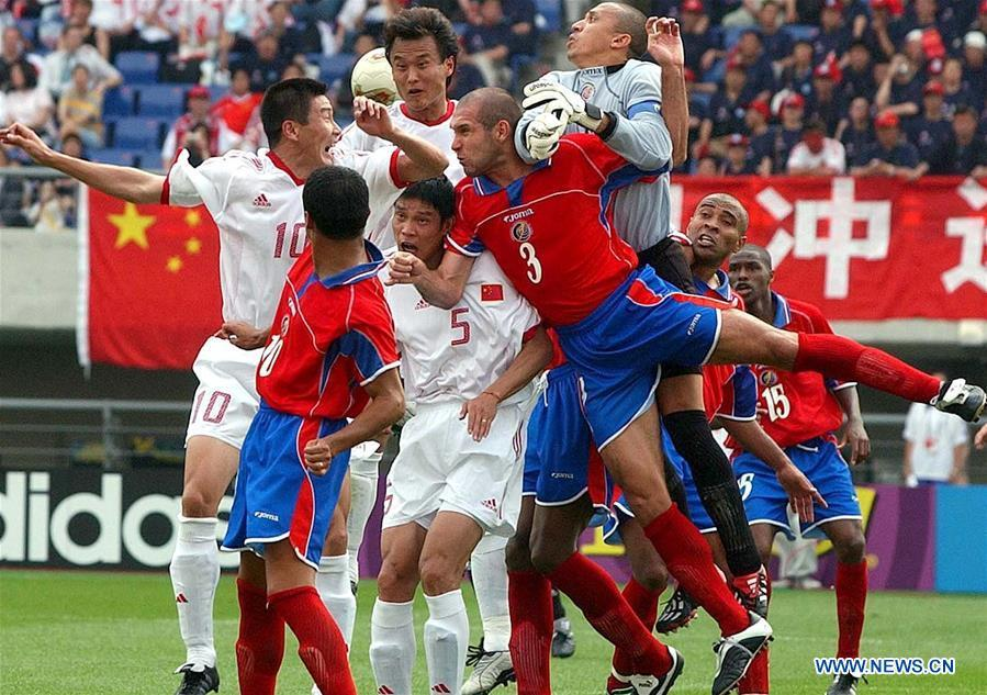 Players of China (in white) and Costa Rica compete during a Group C match at the 2002 FIFA World Cup finals in Gwangju, South Korea, June 4, 2002. This year marks the 70th anniversary of the founding of the People\'s Republic of China (PRC). On April 5, 1959, Rong Guotuan won the champion of the men\'s singles event at the 25th ITTF World Table Tennis Championships in Dortmund, Germany, becoming China\'s first ever world champion. Chinese players have made more achievements during the 60 years since then. (Xinhua/Guo Dayue)