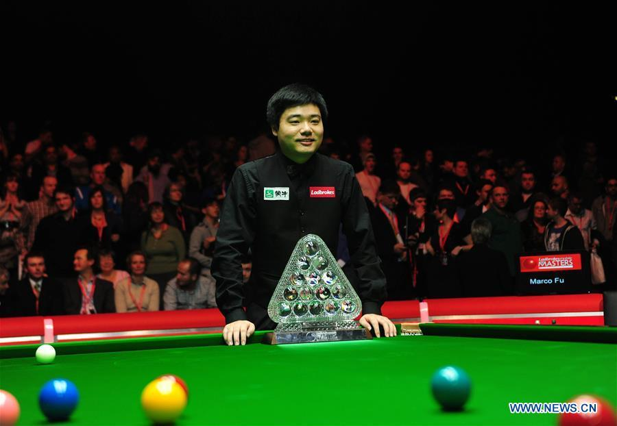 Ding Junhui of China poses with the trophy after winning the 2011 Snooker Masters in London, Britain, Jan. 16, 2011. This year marks the 70th anniversary of the founding of the People\'s Republic of China (PRC). On April 5, 1959, Rong Guotuan won the champion of the men\'s singles event at the 25th ITTF World Table Tennis Championships in Dortmund, Germany, becoming China\'s first ever world champion. Chinese players have made more achievements during the 60 years since then. (Xinhua/Zeng Yi)