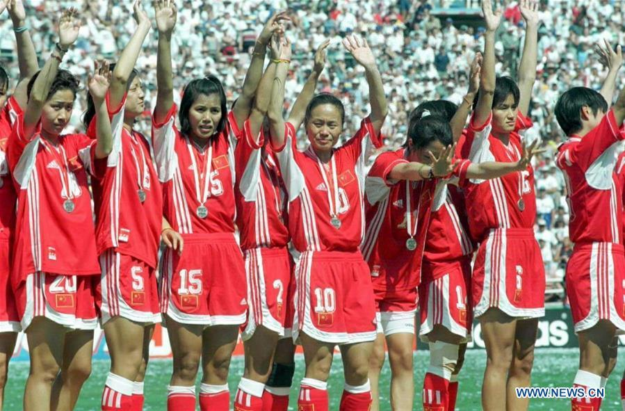 Chinese players attend the awarding ceremony after winning the silver medal at the 3rd FIFA Women\'s World Cup finals in Los Angeles, the United States, July 10, 1999. This year marks the 70th anniversary of the founding of the People\'s Republic of China (PRC). On April 5, 1959, Rong Guotuan won the champion of the men\'s singles event at the 25th ITTF World Table Tennis Championships in Dortmund, Germany, becoming China\'s first ever world champion. Chinese players have made more achievements during the 60 years since then. (Xinhua/Wang Yan)