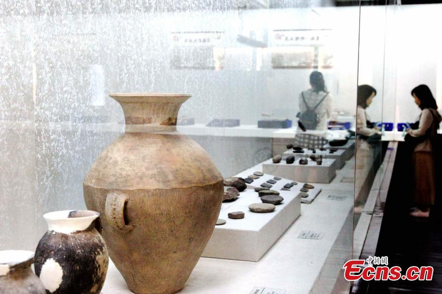 Some 192 artifacts made of stone, bone, pottery and bronze, unearthed from the Shenna site, are on display at an exhibition at the Xining Museum in Xining City, Northwest China's Qinghai Province, June 12, 2019. Shenna is located on the bank of the Beichuan River in Xining, covering an area of approximately 100,000 square meters. It was home to the Qijia culture approximately 4,000 years ago. (Photo: China News Service/ Zhang Tianfu)