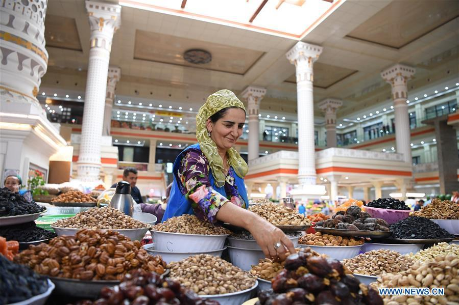 A vendor sells dried fruits and nuts in Dushanbe, capital of Tajikistan, June 10, 2019. (Xinhua/Sadat)