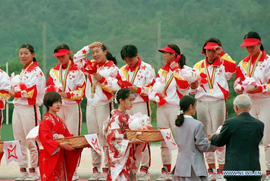 Members of the women\'s softball team of China attend the awarding ceremony after winning the gold at the Asian Games in Hiroshima, Japan, Oct. 7, 1994. This year marks the 70th anniversary of the founding of the People\'s Republic of China (PRC). On April 5, 1959, Rong Guotuan won the champion of the men\'s singles event at the 25th ITTF World Table Tennis Championships in Dortmund, Germany, becoming China\'s first ever world champion. Chinese players have made more achievements during the 60 years since then. (Xinhua/Guan Tianyi)