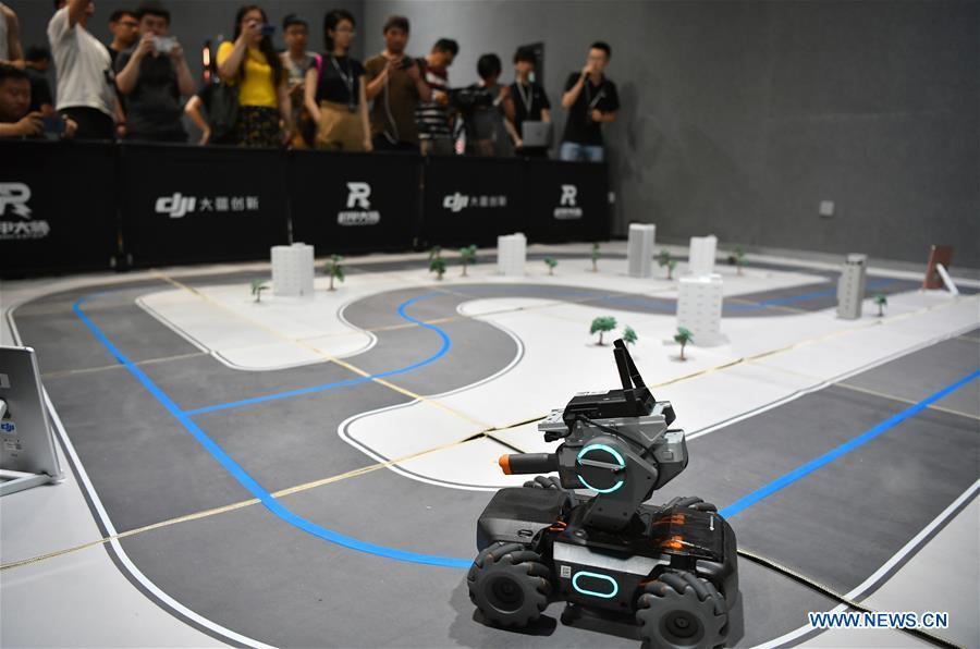 Photo taken on June 12, 2019 shows an educational robot produced by Chinese drone maker DJI at an event in Beijing, capital of China. DJI launched its first educational robot RoboMaster S1 at an event on Wednesday. The robot, supporting 2 programming languages, features a configuration of 31 sensors and 46 programmable components. (Xinhua/Wang Qingqin)