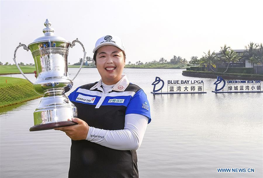 Feng Shanshan of China shows the trophy after claiming the title at the Blue Bay LPGA in Lingshui, south China\'s Hainan Province, Nov. 11, 2017. This year marks the 70th anniversary of the founding of the People\'s Republic of China (PRC). On April 5, 1959, Rong Guotuan won the champion of the men\'s singles event at the 25th ITTF World Table Tennis Championships in Dortmund, Germany, becoming China\'s first ever world champion. Chinese players have made more achievements during the 60 years since then. (Xinhua)
