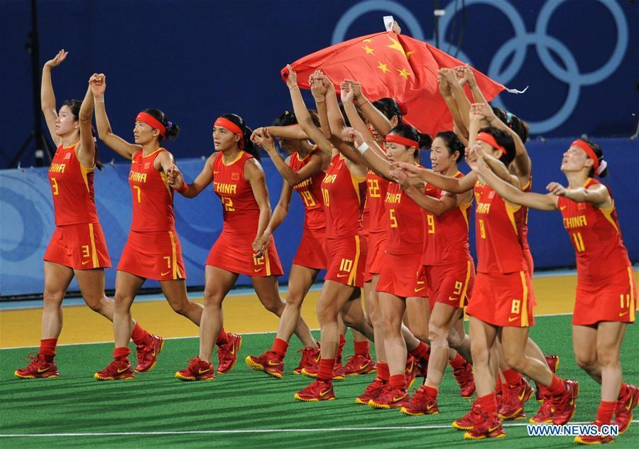 Members of the women\'s hockey team of China celebrate after winning the silver medal at the Olympic Games in Beijing, capital of China, Aug. 22, 2008. This year marks the 70th anniversary of the founding of the People\'s Republic of China (PRC). On April 5, 1959, Rong Guotuan won the champion of the men\'s singles event at the 25th ITTF World Table Tennis Championships in Dortmund, Germany, becoming China\'s first ever world champion. Chinese players have made more achievements during the 60 years since then. (Xinhua/Yang Lei)