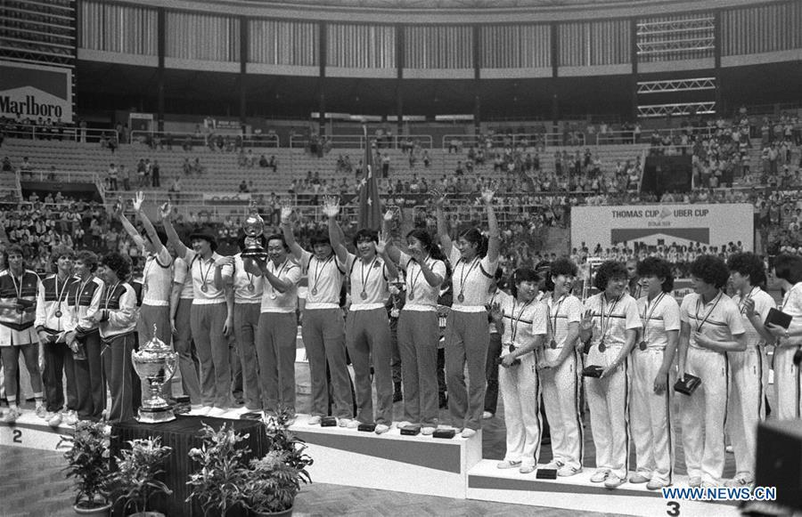Members of the Chinese badminton team attend the awarding ceremony after winning the champion at the 10th Uber Cup badminton tournament in Kuala Lumpur, Malaysia, May 17, 1984. This year marks the 70th anniversary of the founding of the People\'s Republic of China (PRC). On April 5, 1959, Rong Guotuan won the champion of the men\'s singles event at the 25th ITTF World Table Tennis Championships in Dortmund, Germany, becoming China\'s first ever world champion. Chinese players have made more achievements during the 60 years since then. (Xinhua)