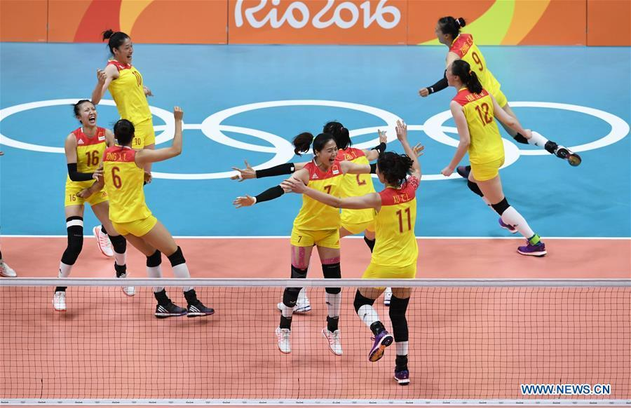 Members of the women\'s volleyball team of China celebrate after winning the gold medal at the Olympic Games in Rio de Janeiro, Brazil, Aug. 20, 2016. This year marks the 70th anniversary of the founding of the People\'s Republic of China (PRC). On April 5, 1959, Rong Guotuan won the champion of the men\'s singles event at the 25th ITTF World Table Tennis Championships in Dortmund, Germany, becoming China\'s first ever world champion. Chinese players have made more achievements during the 60 years since then. (Xinhua/Qi Heng)