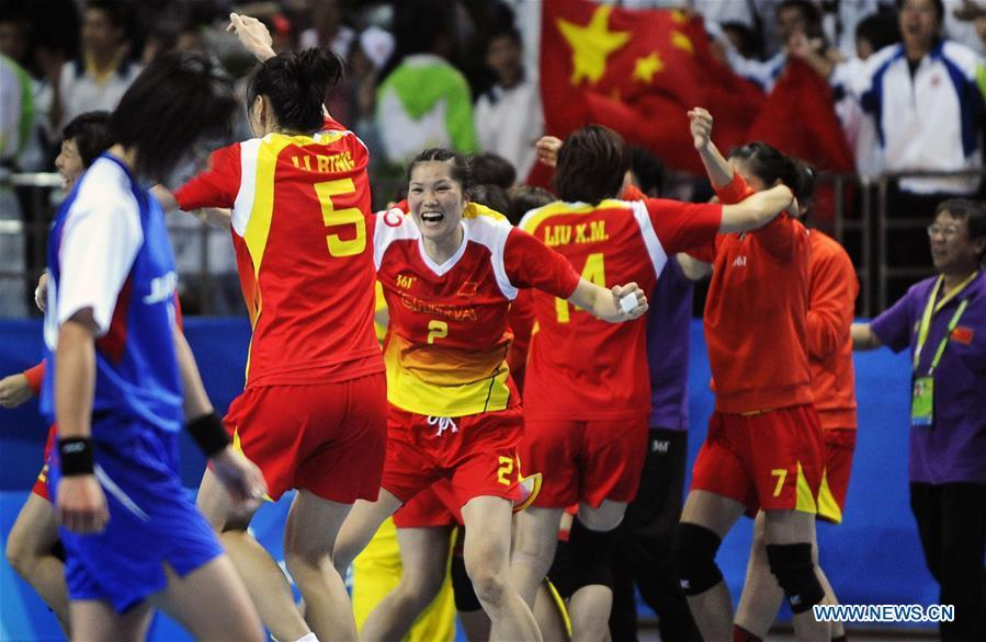 Members of the women\'s handball team of China celebrate victory after the final with Japan at the Asian Games in Guangzhou, capital of south China\'s Guangdong Province, Nov. 26, 2010. This year marks the 70th anniversary of the founding of the People\'s Republic of China (PRC). On April 5, 1959, Rong Guotuan won the champion of the men\'s singles event at the 25th ITTF World Table Tennis Championships in Dortmund, Germany, becoming China\'s first ever world champion. Chinese players have made more achievements during the 60 years since then. (Xinhua/Lu Hanxin)