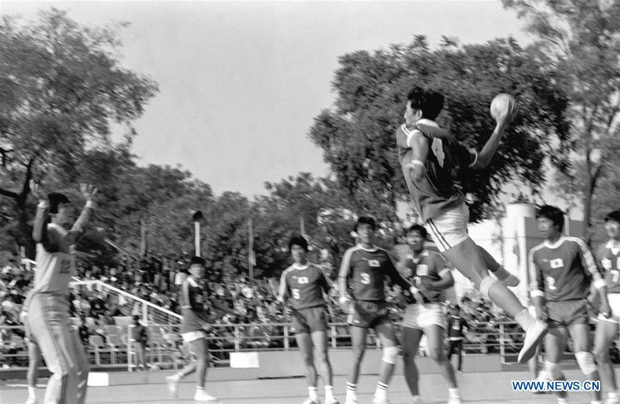 Wu Mingqun of China competes during the men\'s handball final against Japan at the Asian Games in New Delhi, India, Nov. 30, 1982. This year marks the 70th anniversary of the founding of the People\'s Republic of China (PRC). On April 5, 1959, Rong Guotuan won the champion of the men\'s singles event at the 25th ITTF World Table Tennis Championships in Dortmund, Germany, becoming China\'s first ever world champion. Chinese players have made more achievements during the 60 years since then. (Xinhua/Liu Xinning)