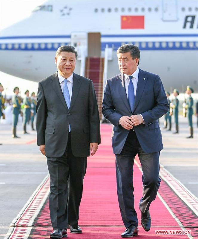 Chinese President Xi Jinping is received by his Kyrgyz counterpart Sooronbay Jeenbekov upon his arrival in Bishkek, Kyrgyzstan, June 12, 2019. Xi arrived here Wednesday for a state visit to Kyrgyzstan and the 19th Shanghai Cooperation Organization (SCO) summit. (Xinhua/Xie Huanchi)