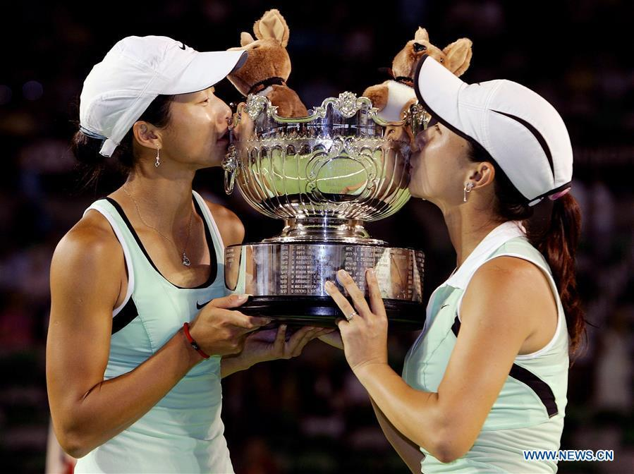 Zheng Jie (R) and Yan Zi kiss the trophy of the women\'s doubles champion at the Australian Open tennis tournament in Melbourne Jan. 27, 2006. This year marks the 70th anniversary of the founding of the People\'s Republic of China (PRC). On April 5, 1959, Rong Guotuan won the champion of the men\'s singles event at the 25th ITTF World Table Tennis Championships in Dortmund, Germany, becoming China\'s first ever world champion. Chinese players have made more achievements during the 60 years since then. (Xinhua)