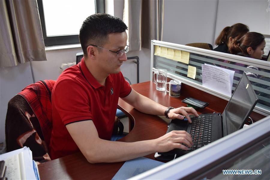 Sadyrbek, a Kyrgyz PhD candidate studying in China, revises his doctoral dissertation at the office of Xinjiang Institute of Ecology and Geography of Chinese Academy of Sciences in Urumqi, northwest China\'s Xinjiang Uygur Autonomous Region, June 11, 2019. (Xinhua/Bai Jiali)