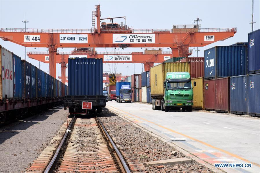 Photo taken on June 12, 2019 shows the containers at the Qingdao multimodal transportation center at a demonstration zone for China-SCO local economic and trade cooperation in Jiaozhou City, east China\'s Shandong Province. (Xinhua/Li Ziheng)
