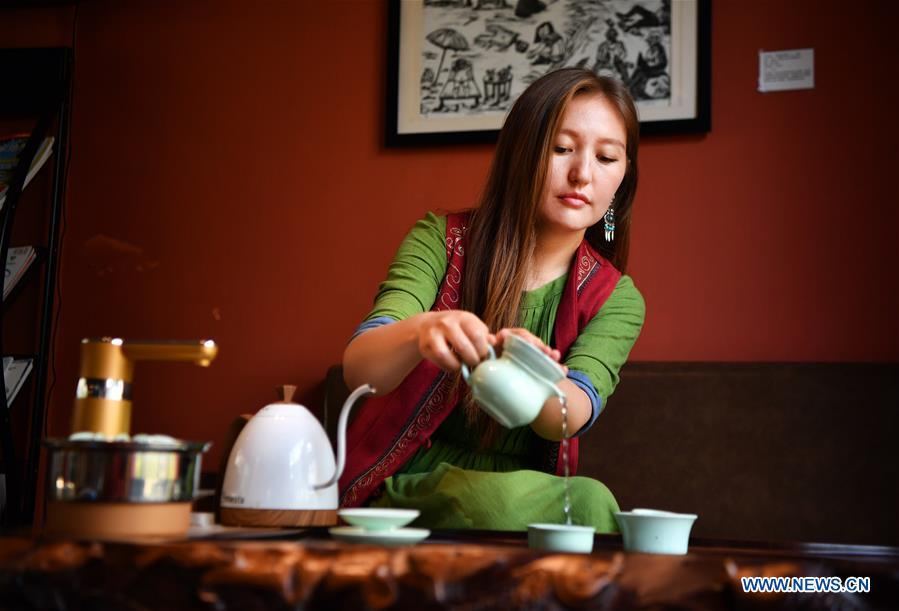 Takyrbasheva Asel, a student from Kyrgyzstan, performs tea art at a teahouse in Hainan University in Haikou, south China\'s Hainan Province, June 13, 2019. Kyrgyz girl Takyrbasheva Asel majors in Tourism Management in Hainan University. She has dedicated herself in experiencing the Chinese culture, including the learning of traditional Chinese musical instruments, Taiji and martial arts, and tea art since she came to China three years ago. She hoped she could stay in China after graducation and invite people from her hometown to come and experience the Chinese culture. Statistics showed that over 4,600 Kyrgyz students studied in China in 2018. (Xinhua/Guo Cheng)