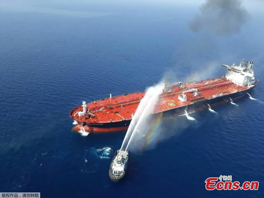 Two oil tankers have been attacked in the Gulf of Oman, leaving one ablaze and both adrift, raising regional tensions a month after a similar incident involving four tankers. The attacks occurred along one of the world's busiest oil routes, and the price of oil surged as the initial reports emerged on June 13, 2019.(Photo/Agencies)