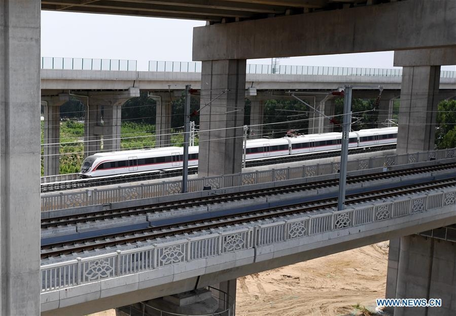 A train runs on a new airport subway line for trial in Beijing, capital of China, June 15, 2019. Self-driving trains for the subway line connecting downtown Beijing with its new international airport started trial run Saturday, according to local authorities. Stretching 41.4 kilometers, the new line supports autopilot system and can run at a speed of 160 km per hour, with as many as 448 passengers, according to Beijing Major Projects Construction Headquarters Office. (Xinhua/Zhang Chenlin)