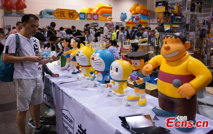 People visit the 2019 Hong Kong Toy Festival held at the Hong Kong Convention and Exhibition Centre, June 16, 2019. Among the festival's highlights are displays of toys from the past, a nostalgic reminder for adults of their childhood memories.  (Photo: China News Service/Zhang Wei)