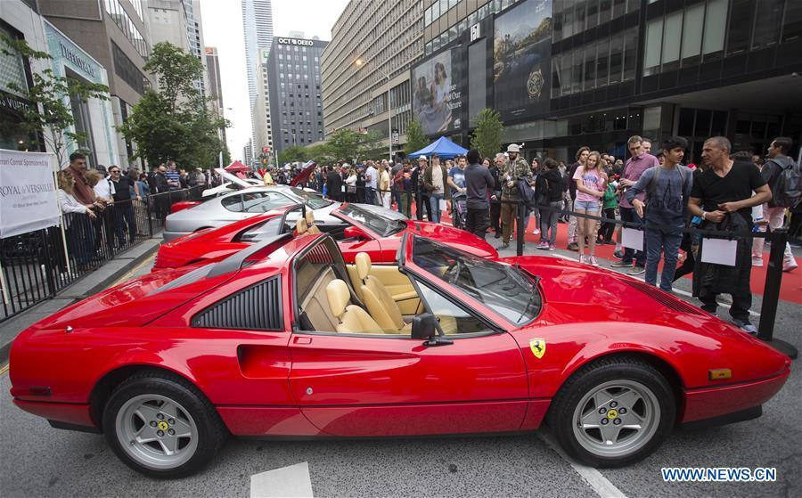 People visit the 2019 Yorkville Exotic Car Show in Toronto, Canada, June 16, 2019. More than 110 classic and exotic cars were displayed at the annual Father\'s Day event on Sunday, attracting tens of thousands of visitors. (Xinhua/Zou Zheng)