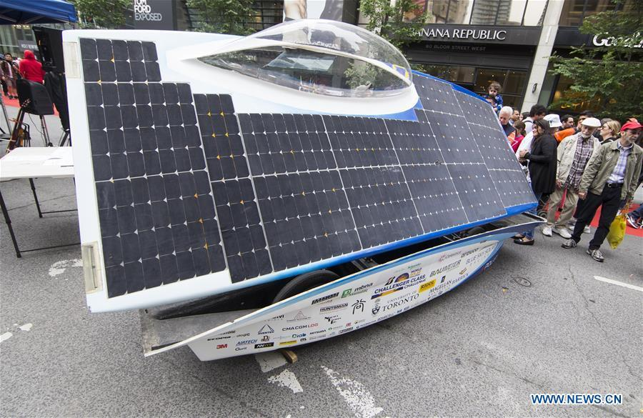 A solar vehicle is seen during the 2019 Yorkville Exotic Car Show in Toronto, Canada, June 16, 2019. More than 110 classic and exotic cars were displayed at the annual Father\'s Day event on Sunday, attracting tens of thousands of visitors. (Xinhua/Zou Zheng)