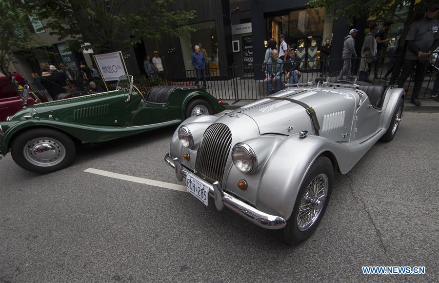 A 1968 Morgan (R) is seen during the 2019 Yorkville Exotic Car Show in Toronto, Canada, June 16, 2019. More than 110 classic and exotic cars were displayed at the annual Father\'s Day event on Sunday, attracting tens of thousands of visitors. (Xinhua/Zou Zheng)
