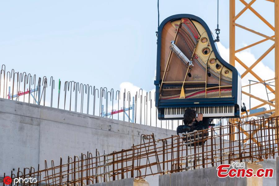 Pianist-composer Alain Roche played his vertical piano during a performance on the occasion of an Open Day at the construction site of the future Theatre de Carouge, in Carouge near Geneva, Switzerland, Sunday, June 15, 2019. (Photo/IC)