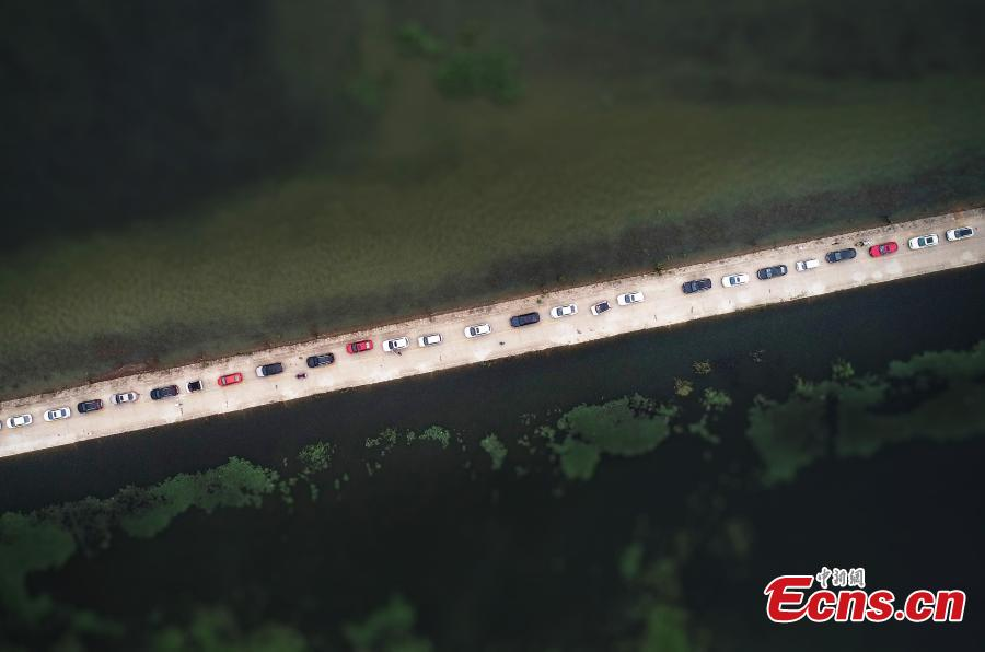 Photo taken on June 16, 2019 shows the submerged Dahuchi section of Yongxiu-Wucheng Road in East China\'s Jiangxi province. Continuous rain in Jiangxi has led to a rise of water level of the Poyang Lake, China\'s largest freshwater lake. The Dahuchi section of Yongxiu-Wucheng Road was submerged in water. (Photo: China News Service/Mao Jiajia)