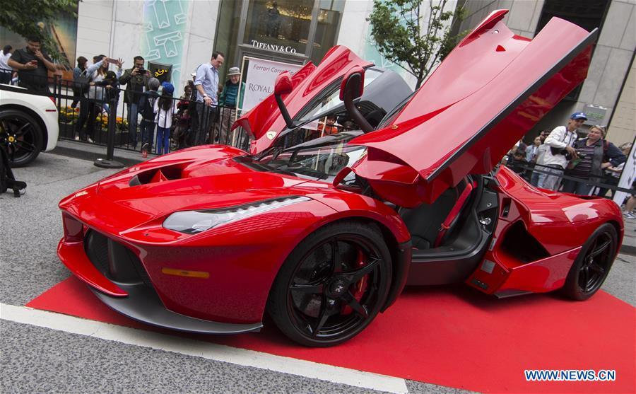 A Ferrari F150 is seen during the 2019 Yorkville Exotic Car Show in Toronto, Canada, June 16, 2019. More than 110 classic and exotic cars were displayed at the annual Father\'s Day event on Sunday, attracting tens of thousands of visitors. (Xinhua/Zou Zheng)