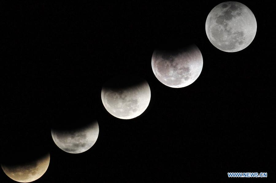 Public flock to see 'super blue red moon' in China