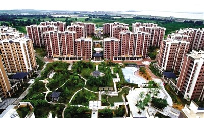 New land for old houses, new houses for old folks -- China's win-win land swaps
