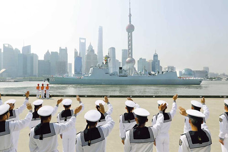 Chinese naval ships leaving Shanghai yesterday for visits to over 20 countries. The fleet, comprising missile destroyer Changchun, missile frigate Jingzhou and supply ship Chaohu, will tour Asia, Europe, Africa and Oceania for nearly six months. (Photo/Shanghai Daily)