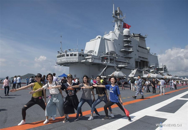 Visitors pose for photos on the flight deck of the Liaoning in Hong Kong, July 9, 2017. (Photo/Xinhua)