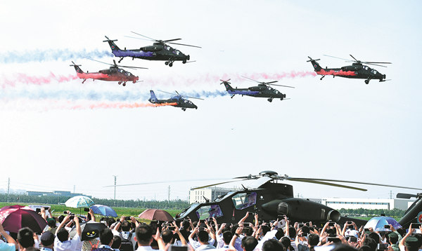The Fenglei aerobatics team of the PLA Ground Force performs at the fourth China Helicopter Expo opening ceremony on Thursday in Tianjin. More than 400 helicopters from 22 countries and regions are on display at the expo. JIA LEI / FOR CHINA DAILY The AV500W unmanned autonomous helicopter is on display at the fourth China Helicopter Expo in Tianjin. ZHAO LEI / CHINA DAILY