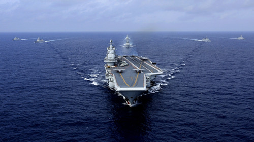 The aircraft carrier CNS Liaoning leads its battle group on its first combat exercise in the western Pacific on Friday. (Hu Kaibing/For China Daily)