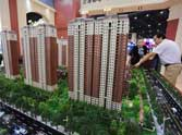 China eases home purchase restriction