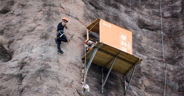 100-meter-high cliff store opens for climbers