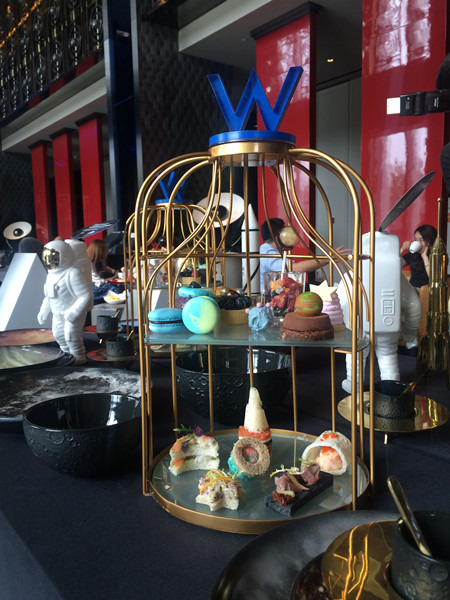 The cosmic afternoon tea set for one is displayed at the lobby lounge of W Beijing Chang'An during a media preview, on June 29, 2016. The three-month themed afternoon tea is available from July 1. (Photo by Jiang Wanjuan/chinadaily.com.cn)