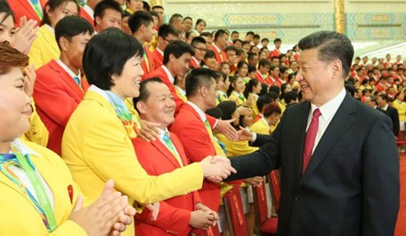 President Xi meets with team China