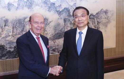 China premier urges U.S. Commerce Secretary to treat investments by Chinese firms fairly