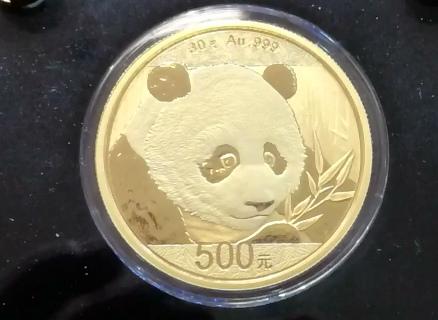 Commemorative panda coins debut in Beijing
