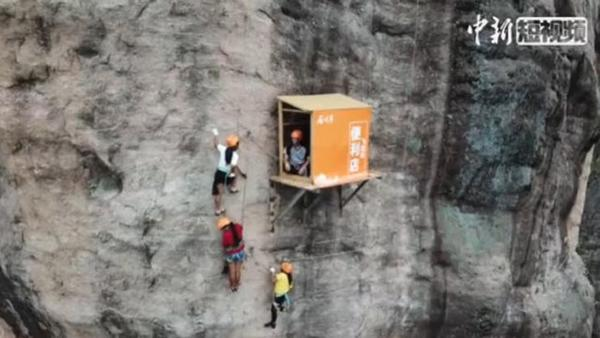 Store hands out gear 100 meters up a sheer cliff