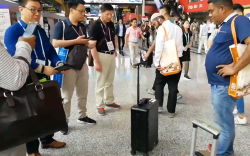 Smart suitcase follows its owner automatically