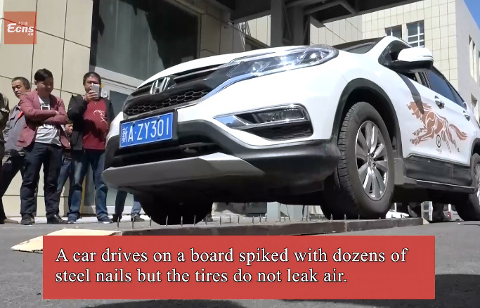 Watch a car drive over nails and not puncture!