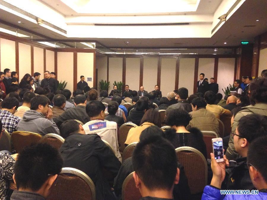 Malaysia Airlines holds press conference on missing flight MH370 in Beijing