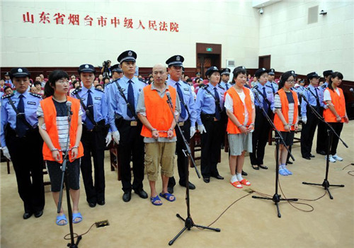 Five cult members stand trial on murder charges in E China