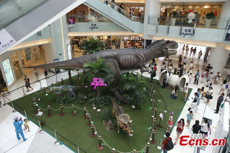 Having fun at 'Jurassic Park' in Beijing mall