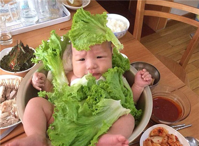 Cute baby posed with food